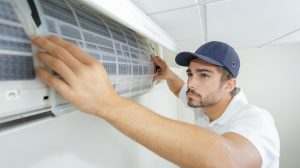 man installing a panel for air system