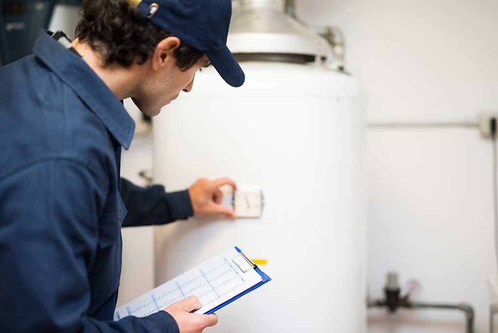 Plumber inspecting residential water heater