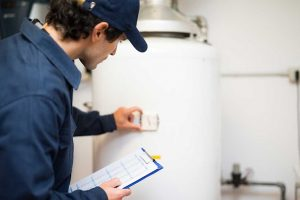Plumber inspecting residential water heater