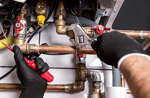 Fort Collins plumber fixing piping