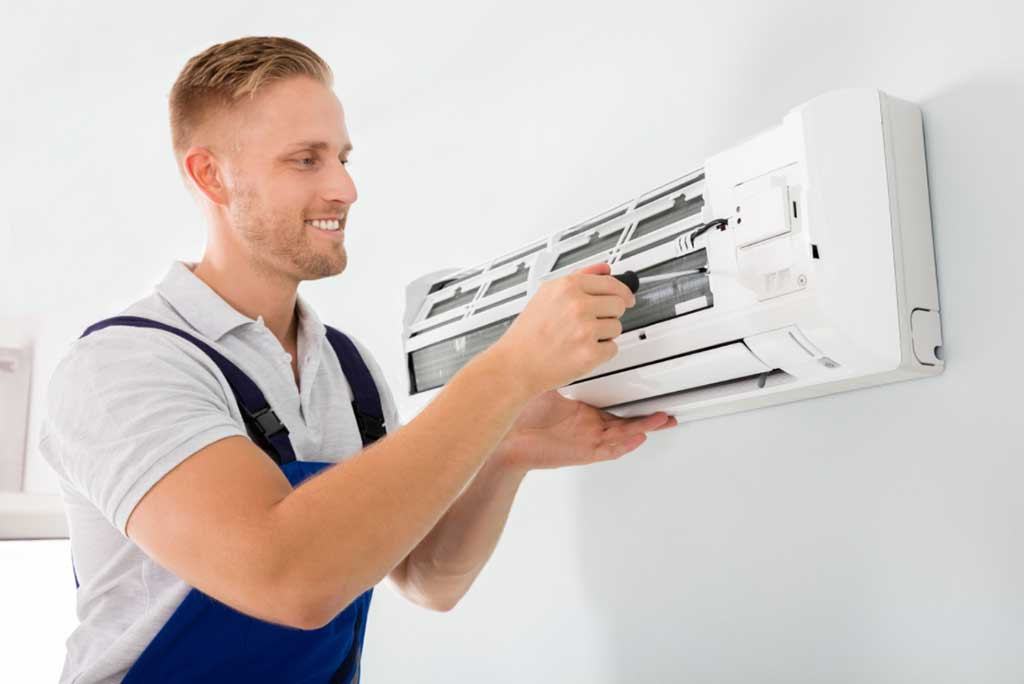 HVAC contractor fixing ductless mini-split system